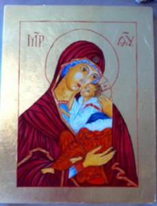 Szűz Mária édesanyja ölében